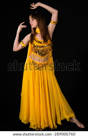 Tall slim brunette in a yellow belly dance costume