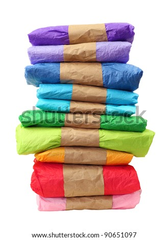 Tall stack of brightly wrapped gifts on a white background