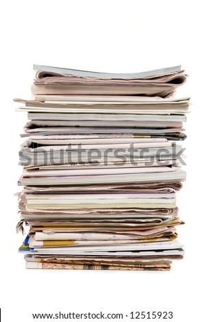 Tall stack of old newspapers and magazines isolated on white background, vertical