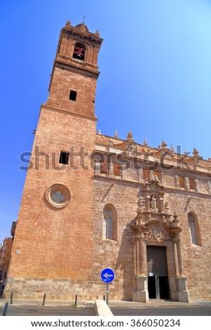Tall stone belfry above the church of Los Santos Juan, Valencia, Spain - stock photo