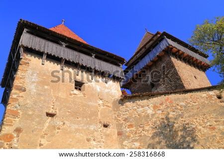 Tall towers defending medieval church on UNESCO world heritage list, Viscri, Romania - stock photo