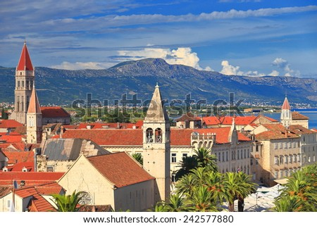 Tall towers of Romanesque churches from the old town of Trogir, Croatia - stock photo