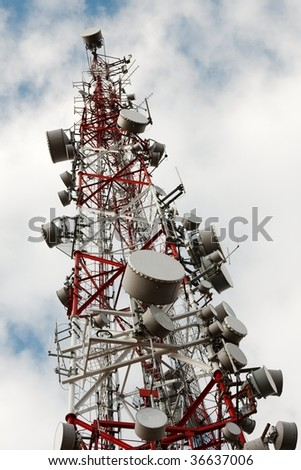 Tall transmitter tower ith lots of antennas - stock photo