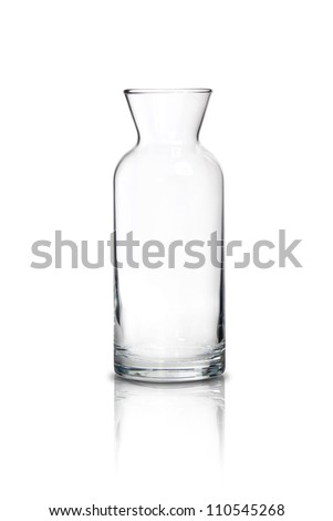 Tall transparent glass jug on white background