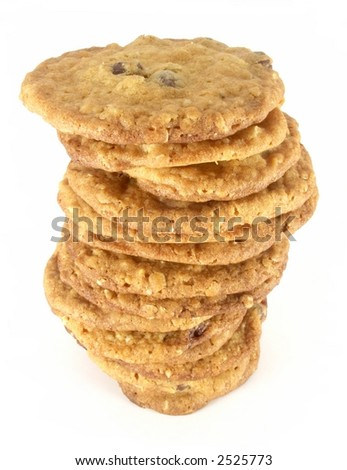 Tall uneven stack of homemade chocolate chip cookies isolated on white background. - stock photo