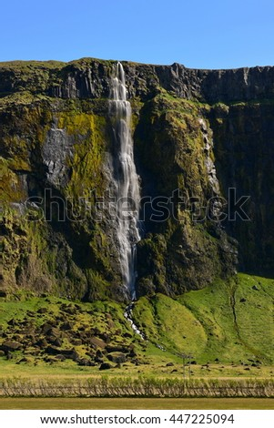 Tall waterfall in southern Iceland