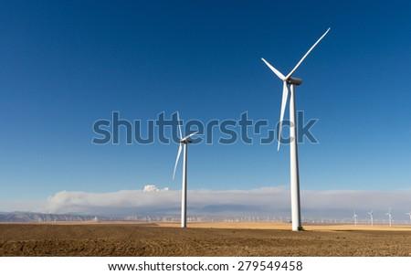 Tall wind turbines generating clean renewable energy - stock photo