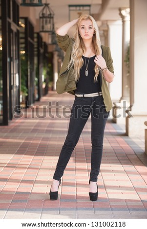Tall young woman with high heels.