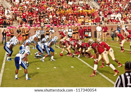TALLAHASSEE, FL - OCT. 27:  FSU offensive line sets for the call from FSU Quarterback, EJ Manuel, as they face Duke University during Homecoming weekend at Doak Campbell Stadium on Oct. 27, 2012.