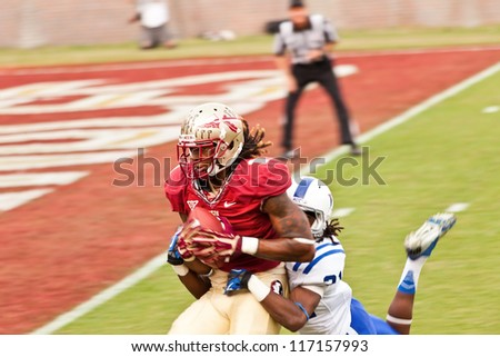 TALLAHASSEE, FL - OCT. 27:  FSU's wide receiver, Kelvin Benjamin, runs for Seminole touchdown while being tackled by Duke University player at Doak Campbell Stadium on Oct. 27, 2012.
