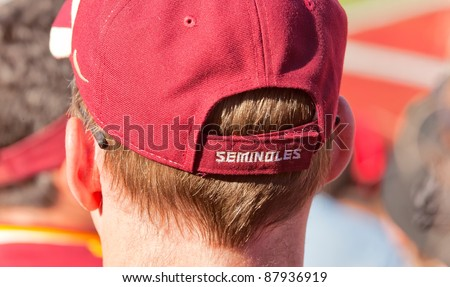 TALLAHASSEE, FLORIDA - OCT 22:  Florida State football fan wears a hat showing support for FSU football team as they play the Maryland Terps at Doak Campbell Stadium on Oct. 22, 2011. - stock photo