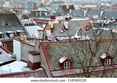 Tallin rooftops in a hazy enening - stock photo
