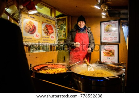 TALLINN - December 20, 2014: Market food seller - Christmas market at Town Hall Square in Old Town