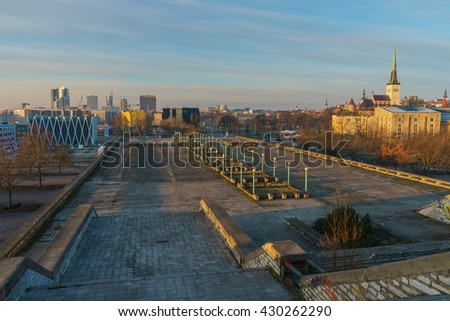 Tallinn, Estonia - April 24, 2016: Architecture of medieval time, soviet era and modern days side-by-side. Overlook view from Linnahall by early morning.
