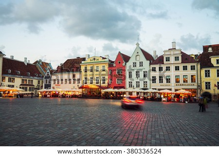 TALLINN, ESTONIA - AUGUST 30, 2015: Old buildings, restaurants and cafes of the Town Hall square in old historical area in the popular European city of Baltic region. Lights and illumination - stock photo