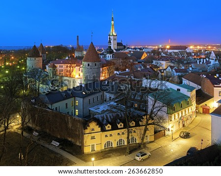 Tallinn, Estonia. Evening view from the Patkuli viewing platform of the Lower Town with St. Olaf's Church, Transfiguration Cathedral and towers of Tallinn City Wall. - stock photo