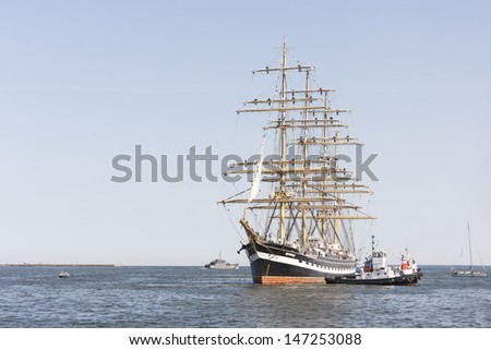 TALLINN, ESTONIA - JULY 12, 2013: Kruzenshtern or Krusenstern sail ship arrives to Tallinn Maritime Days on July 12, 2013 in Tallinn, Estonia
