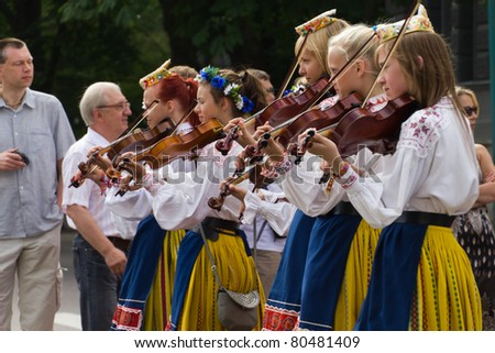 TALLINN, ESTONIA - JULY 3: Total unidentified of 22239 singers and 2111 orchestra players march on the parade of the 11th Youth Song and Dance Celebration in Tallinn, Estonia on July 3rd 2011. - stock photo