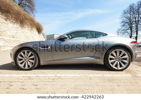 Tallinn, Estonia - May 2, 2016: Gray metallic Jaguar F-Type coupe S, side view. Two-seat sports car, based on platform of the XK convertible, manufactured by British manufacturer Jaguar Cars from 2013