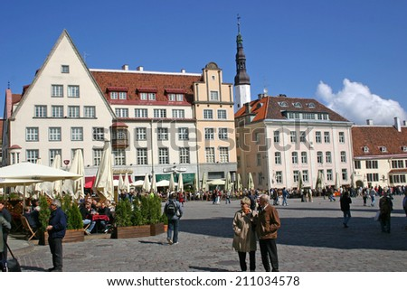 TALLINN, ESTONIA-MAY 16:Tallinn's Town Hall Square dates back to the Middle Ages and today is a popular shopping and cafe scene for the many locals and tourists in the city on May 16, 2008. - stock photo