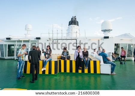TALLINN, ESTONIA - SEP 7, 2014: Upper deck at the Cruiseferry of the Estonian company Tallink. It is one of the largest passenger and cargo shipping companies in the Baltic Sea region - stock photo