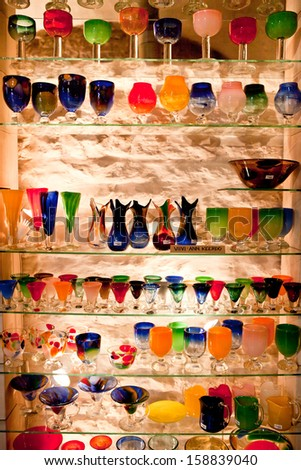 TALLINN, ESTONIA - SEPTEMBER 15: Traditional locally-made murano glass products in souvenir shop on September 15, 2013 in Tallinn, Estonia.  - stock photo