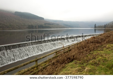 Talybont Reservoir, Wales. Talybont reservoir feeds into an hydroelectric plant, making electricity for the valleys. The reservoir is large and deep, collecting water from the surrounding mountains. - stock photo