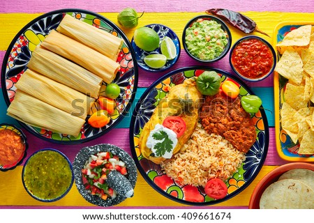 Tamale with corn leaf and filled chili pepper poblano guacamole  sauces - stock photo