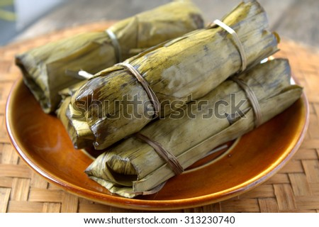 Tamales are a mix of meat and vegetables with rice or corn folded in a banana leaf and then steamed.