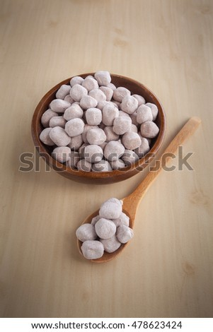 Tamarind candy on wooden background, Candy made from tamarind
