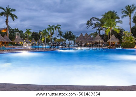 Tambor, Costa Rica - June 22: Beautiful swimming pool at the Barcelo Tambor Beach hotel, photo taken at twilight. June 22 2016, Tambor, Costa Rica.