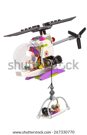 Tambov, Russia - March 14, 2015: Ambulance helicopter evacuates a patient from Lego.  Lego is a line of construction toys manufactured by the Lego Group. - stock photo