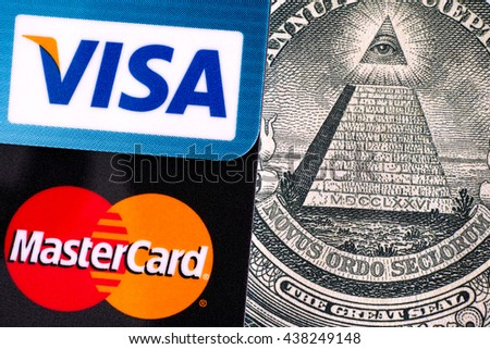 Tambov, Russian Federation - April 02, 2016 Visa and MasterCard logo on credit cards on one dollar bill with pyramid of 13 steps, topped by the Eye of Providence within a triangle. Studio shot. - stock photo