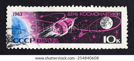 Tambov, Russian Federation - October 02, 2013 USSR postage stamp Cosmonauts Day - Vostok 1- Earth and the Moon. 1963 year. Black background.  - stock photo