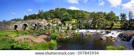 Tambre river and old bridge Maceira, La Coruna, Galicia, Spain - the Pilgrim's Road to Santiago de Compostela - stock photo