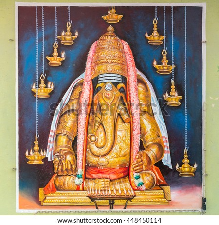 Tamil Nadu, India - October 18, 2013: Pillayarpatti Karpaga Vinayagar temple. Image of the idol Ganesha is fixed on ceiling of the Mandapam in front of the entrance. His pose represent the OM symbol. - stock photo