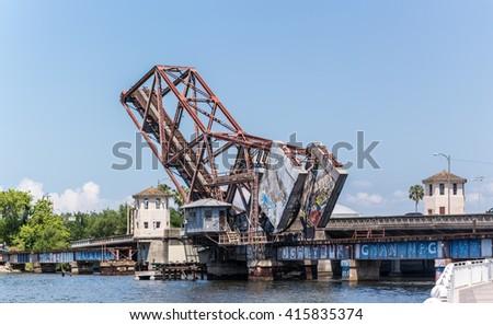 TAMPA, FL/USA - APRIL 28, 2016 Cass Street Rail Bridge Historic landmark spans the Hillsborough River in downtown Tampa, Fl. Built in 1915, bascule bridge, or drawbridge with balancing counterweights. - stock photo