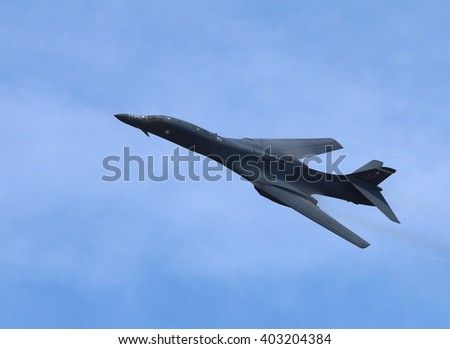TAMPA, FLORIDA - MARCH 20, 2016: A B-1B Lancer with variable-sweep wing during a flyby demonstration for AirFest 2016 held at MacDill Air Force Base. - stock photo