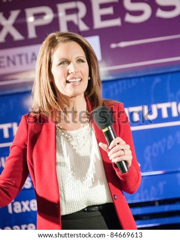 TAMPA - SEPTEMBER 12: Republican candidate Michele Bachmann addresses supporters after the CNN/Tea Party Express debate in Tampa, Florida on September 12, 2011. - stock photo