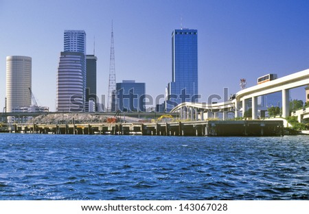 Tampa skyline with shuttle over Tampa Bay, Tampa, Florida - stock photo