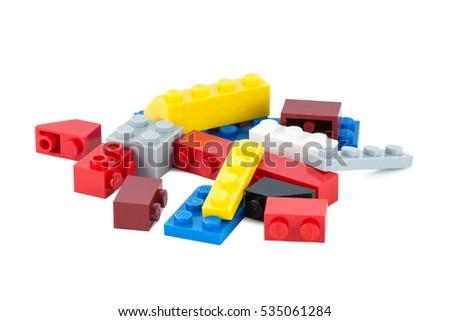 TAMPERE, FINLAND - JULY 12, 2015: Close-up of pile of colorful Lego pieces isolated on white background.