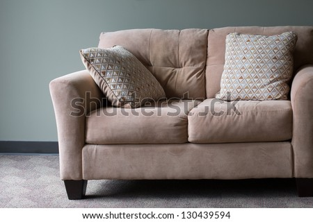 tan blue couch wall interior - stock photo
