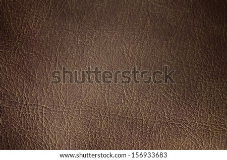 Tan leather texture background. Close-up photo