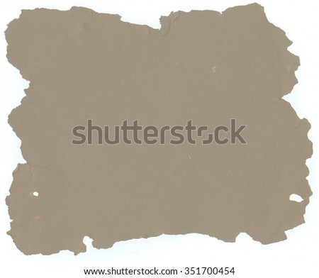 Tan sheet of old torn paper - stock photo