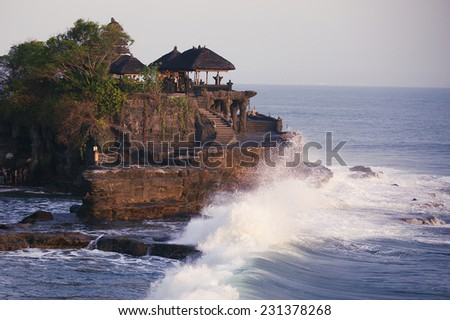 Tanah Lot Temple stand at sunset in indian ocean, Bali Island, I - stock photo
