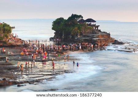 Tanah Lot Temple with people waiting for sunset in Bali Island, Indonesia - stock photo