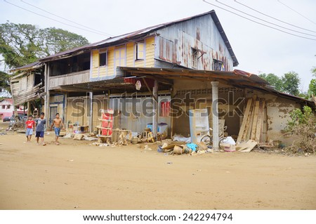 TANAH MERAH, KELANTAN - JANUARY 2: Impact of floods as high as approximately 2 meters is clearly visible in the wooden wall in the house at Kusial Baru village, Tanah Merah, Kelantan on Janury 2, 2015