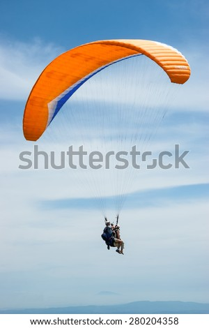 Tandem paragliding - stock photo