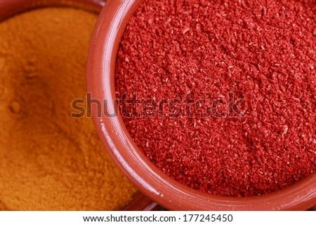Tandoori  spices and curcuma on sack cloth - stock photo