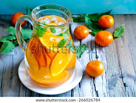 Tangerine and mint homemade lemonade - stock photo